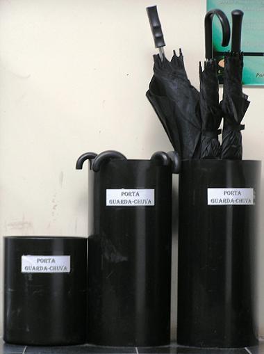 Trash cans turned into umbrellabaskets